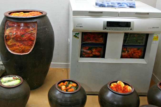Left: a jar used to ferment kimchi; right: a special kimchi fridge